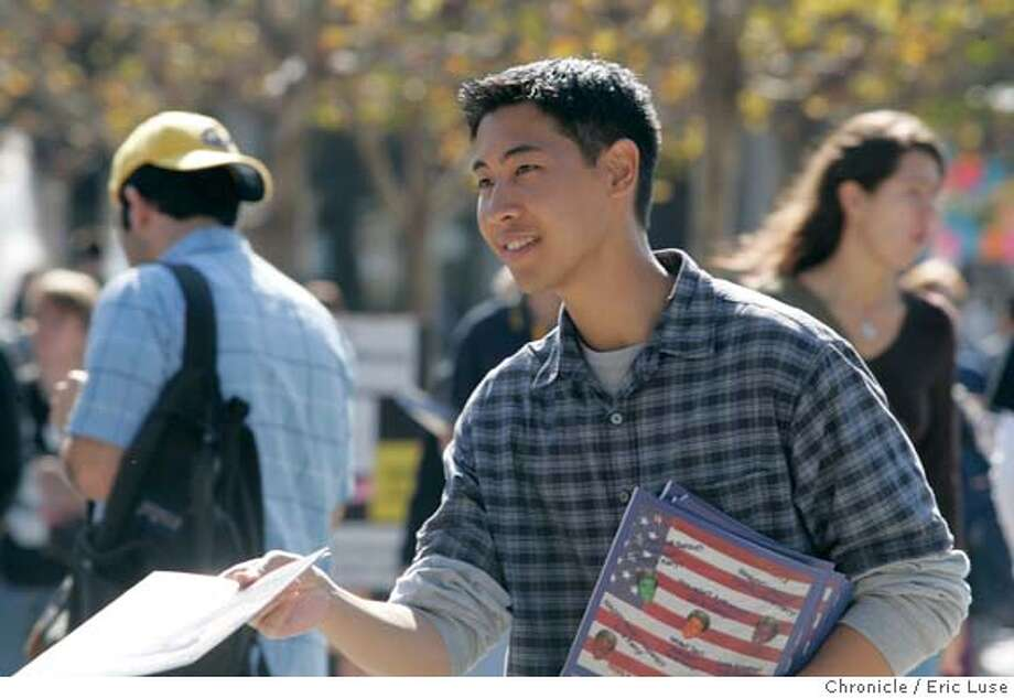 UC Berekely Freshman Andrew Quinio,18 hands out a Republican publication.We go to Cal, Stanford and other Bay Area college campuses to gauge the buzz of political activity on the eve of Tuesday's presidential election. At Cal, we go to Sproul Plaza..Event on 10/30/04 in Berekeley. Eric Luse / The Chronicle Photo: Eric Luse