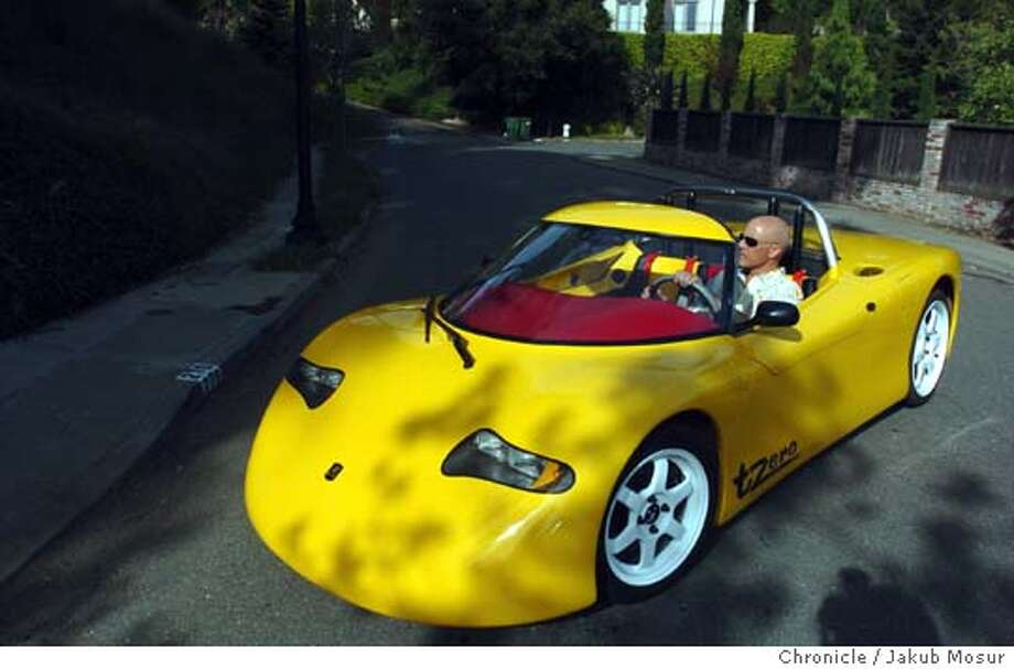 David Wilner drives his electric sports car, the T-Zero, near his home in Berkeley. Event on 4/16/05 in Berkeley. JAKUB MOSUR / The Chronicle Photo: JAKUB MOSUR