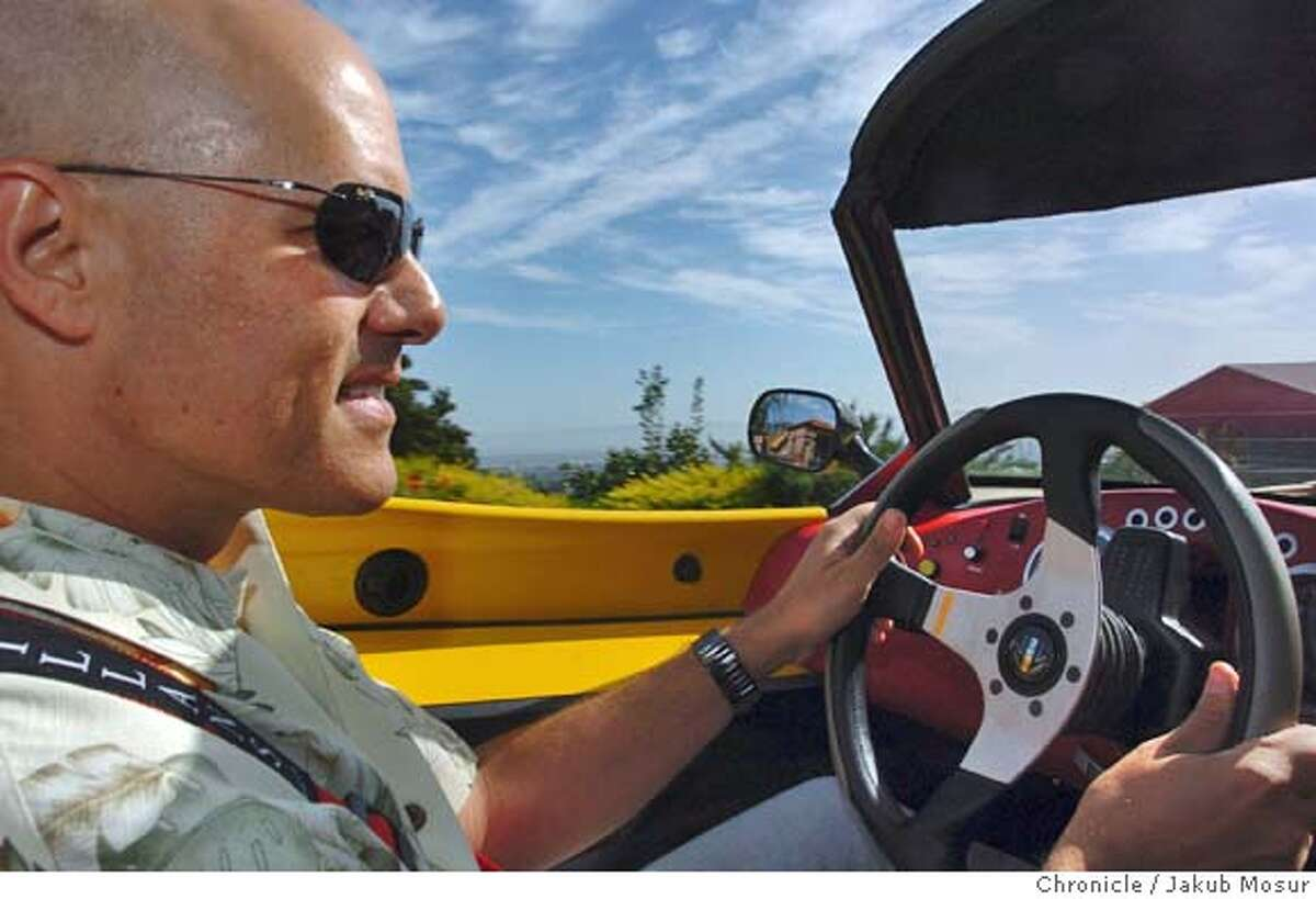 David Wilner drives his electric sports car, the T-Zero, near his home in Berkeley. Event on 4/16/05 in Berkeley. JAKUB MOSUR / The Chronicle