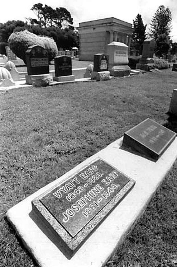 Wyatt Earp's grave at Hills of Eternity in Colma Michael Maloney 1992 Datebook#Datebook#SundayDateBook#10/31/2004#ALL#Advance##0422435699