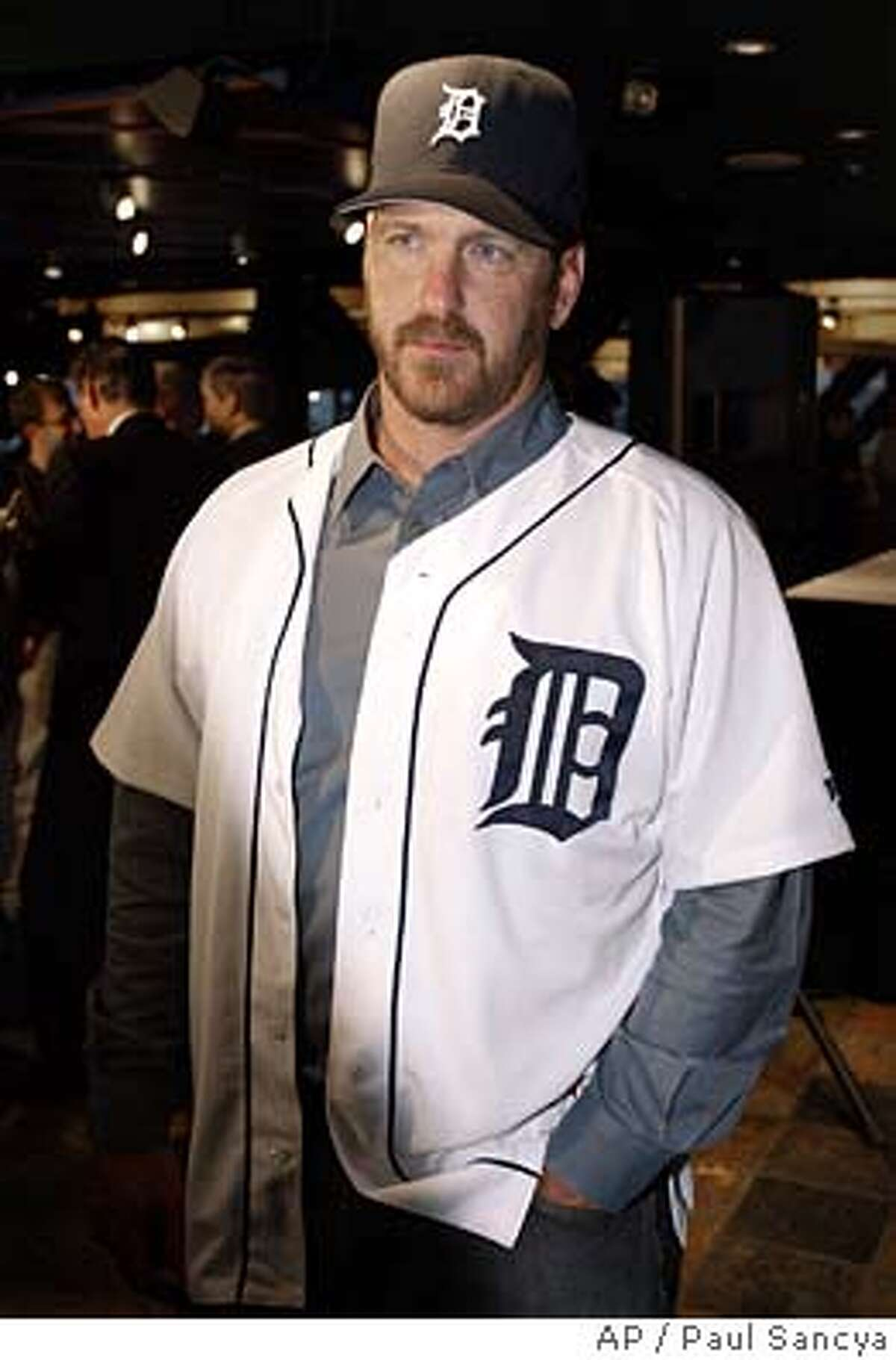 Detroit Tigers relief pitcher Troy Percival speaks to the media after a news conference in Detroit, Wednesday, Nov. 17, 2004. Percival and the Tigers agreed on a $12 million, two-year contract. (AP Photo/Paul Sancya) Ran on: 11-18-2004 Ran on: 11-18-2004