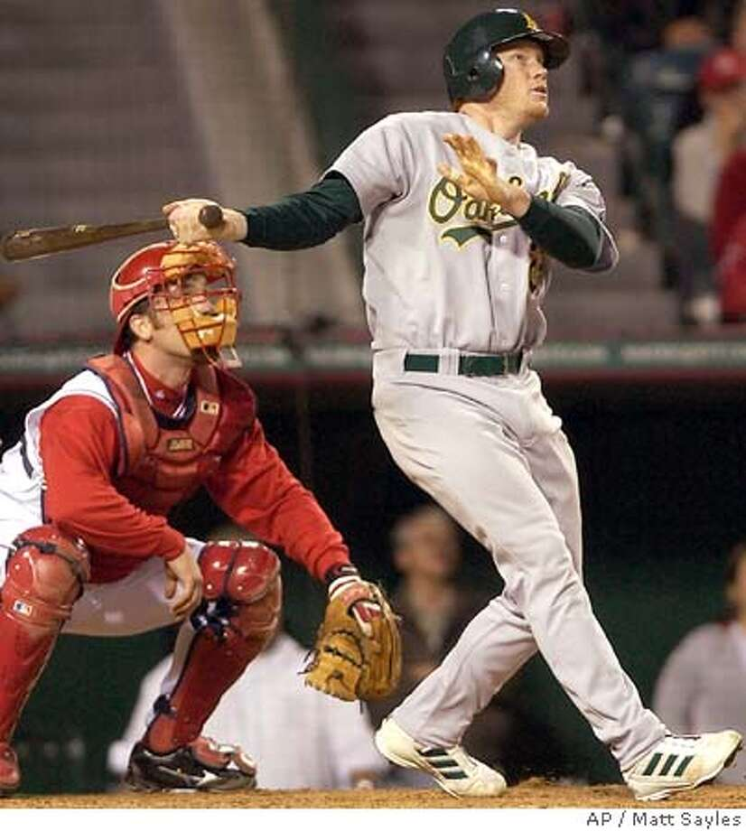 Oakland Athletics' Bobby Kielty watches his three-run home run off of Los Angeles Angels of Anaheim pitcher Paul Byrd in the fifth inning in Anaheim, Calif. on Saturday, April 23, 2005. Scott Hatteberg and Mark Ellis also scored on the play. (AP Photo/Matt Sayles) Photo: MATT SAYLES