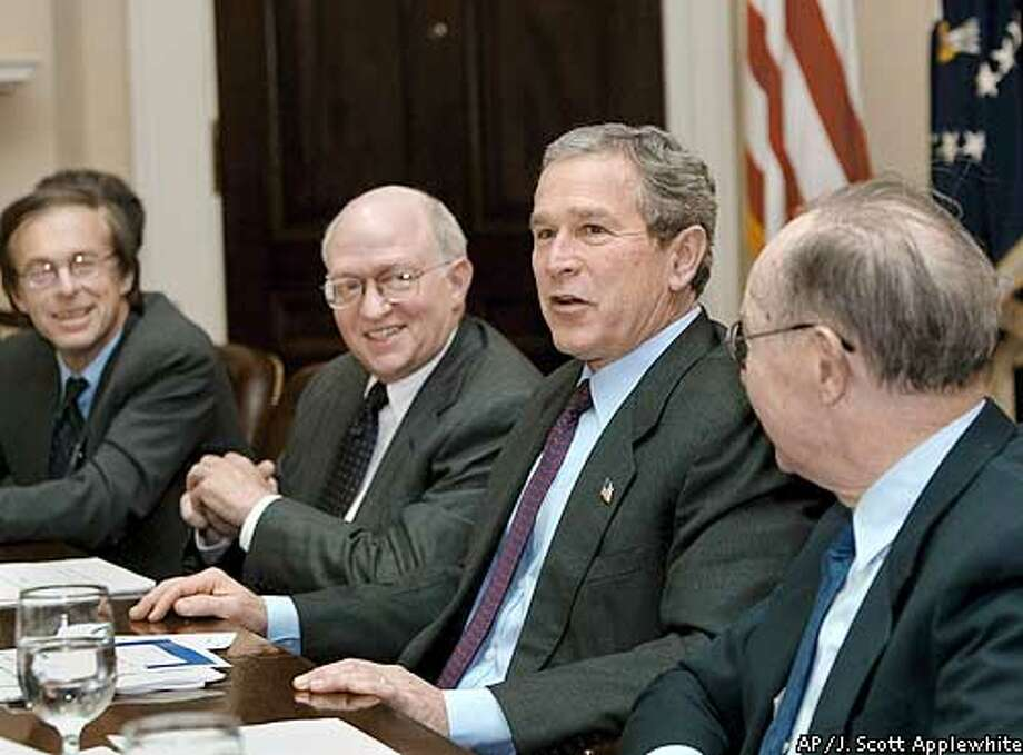 With his plan to stimulate the American marketplace before the Congress and his State of the Union speech a week away, President Bush confers with economists in the Roosevelt Room at the White House, Tuesday, Jan. 21, 2003. Left to right are: Allan Sinai, CEO of Decision Economics, Harvard University Professor of Economics Martin Feldstein, a former chairman of the Council of Economic Advisers under President Reagan, Bush, and Allan Meltzer, economics professor at Carnegie Mellon University. Bush travels to St. Louis on Wednesday to promote his economic recovery plan and tax-cut proposals. (AP Photo/J. Scott Applewhite) Photo: J. SCOTT APPLEWHITE