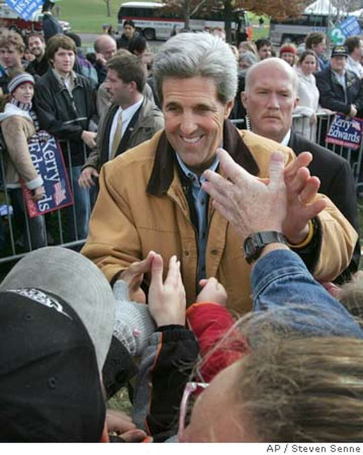 Senator John Kerry, D-Mass., Democratic nominee for President of the United States, shakes hands with the crowd moments after a campaign rally, in Des Moines, Iowa, Saturday, Oct. 30, 2004. (AP Photo/Steven Senne) Ran on: 10-31-2004  President Bush greets supporters at a campaign election rally in Grand Rapids in the closely fought state of Michigan. Photo: STEVEN SENNE