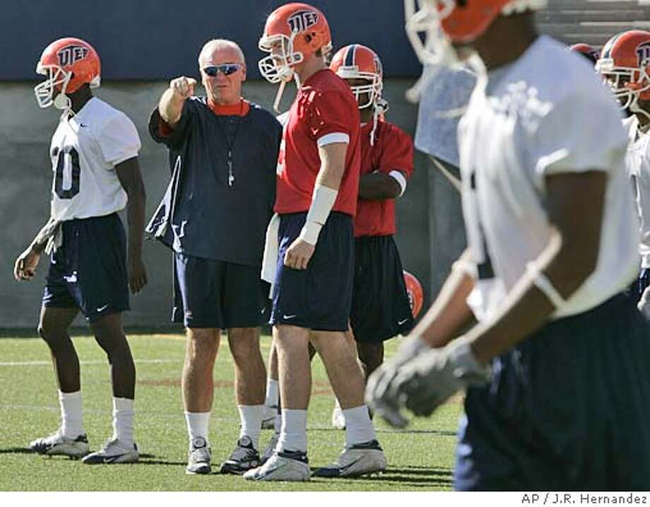 Texas-El Paso coach Mike Price talks with Jordan Palmer, center, during practice Thursday, Oct. 28, 2004, in El Paso, Texas. (AP/ Photo by J.R. Hernandez) Sports#Sports#Chronicle#10/30/2004#ALL#5star##0422438136 Photo: J.R. HERNANDEZ