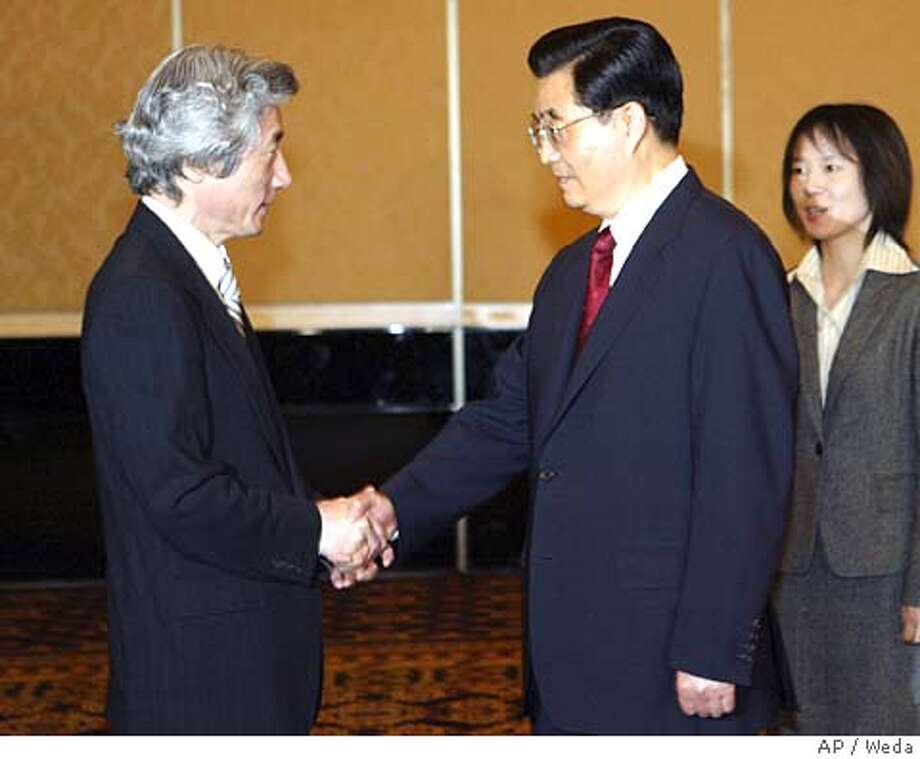 Chinese President Hu Jintao, right, and Japanese Prime Minister Junichiro Koizumi shake hands at the start of their meeting in Jakarta Saturday, April 23, 2005. Their meeting was held on the sidelines of the Asia-Africa summit in an effort to end a dispute over Japan's World War II aggression that has badly damaged relations between the two Asian powers and alarmed their neighbors. (AP Photo/Weda, POOL) Photo: WEDA