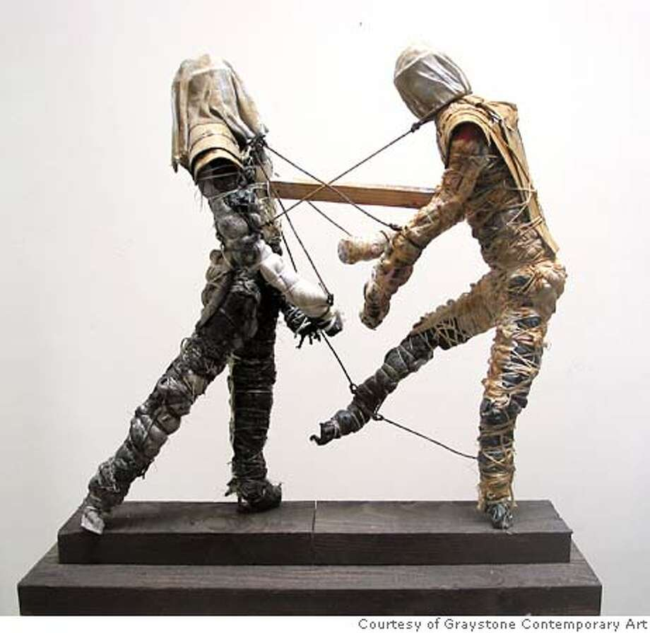 """Two Men"" (2003), Sculpture in rags, string, twine, steel bar, acrylic medium and paint, wood and cardboard by David Maxim.  Courtesy of Graystone Contemporary Art Datebook#Datebook#Chronicle#10/30/2004#ALL#Advance##0422435657 Photo: Courtesy Of Graystone Contempora"