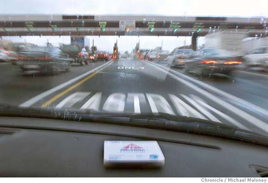 RACE30A-C-29NOV00-SZ-MJM  With a FasTrak device on the dashboard, we had a short 40 yard stretch of clear road approaching the bay bridge toll plaza before it was stop and go again for the metering lights.  CHRONICLE PHOTO BY MICHAEL MALONEY Metro#Metro#Chronicle#10/30/2004#ALL#5star##421805351 Photo: MICHAEL MALONEY