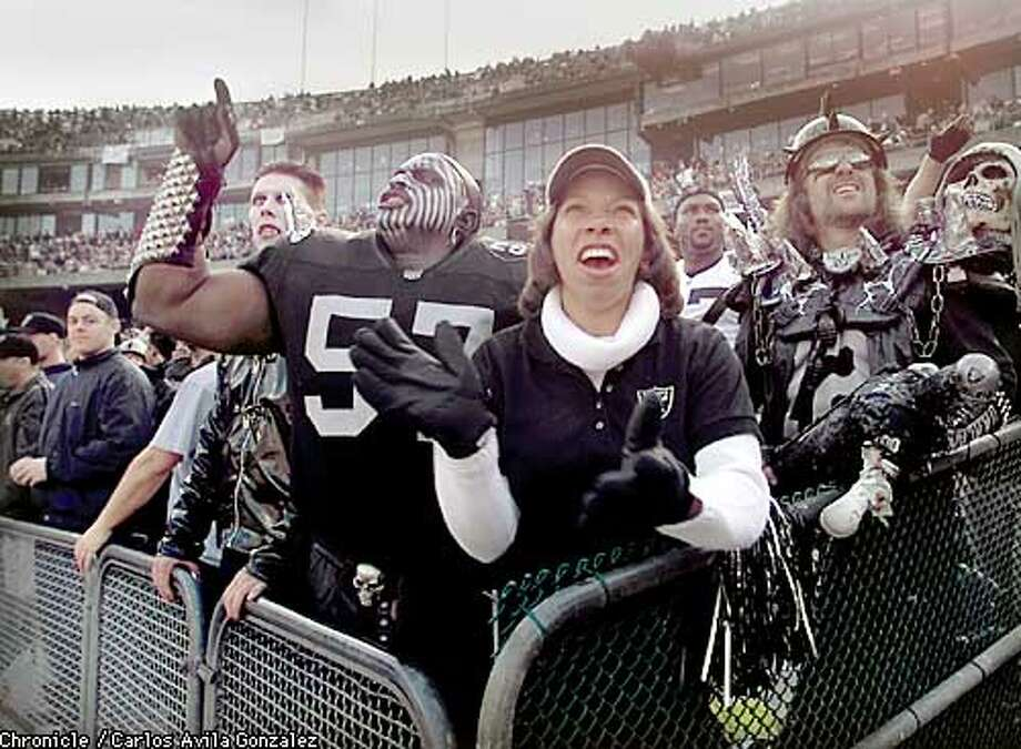 Bertha Robinson, with her boyfriend, Violator, left, of Rancho Cucamonga, Ca., and Mark Shadinger, right, of Antelope, Ca., right, cheer the Oakland Raiders on Saturday, January 6, 2001, during the AFC Division Playoffs at Network Associates Coliseum in Oakland, Ca.  (CARLOS AVILA GONZALEZ/SAN FRANCISCO CHRONICLE) Photo: CARLOS AVILA GONZALEZ