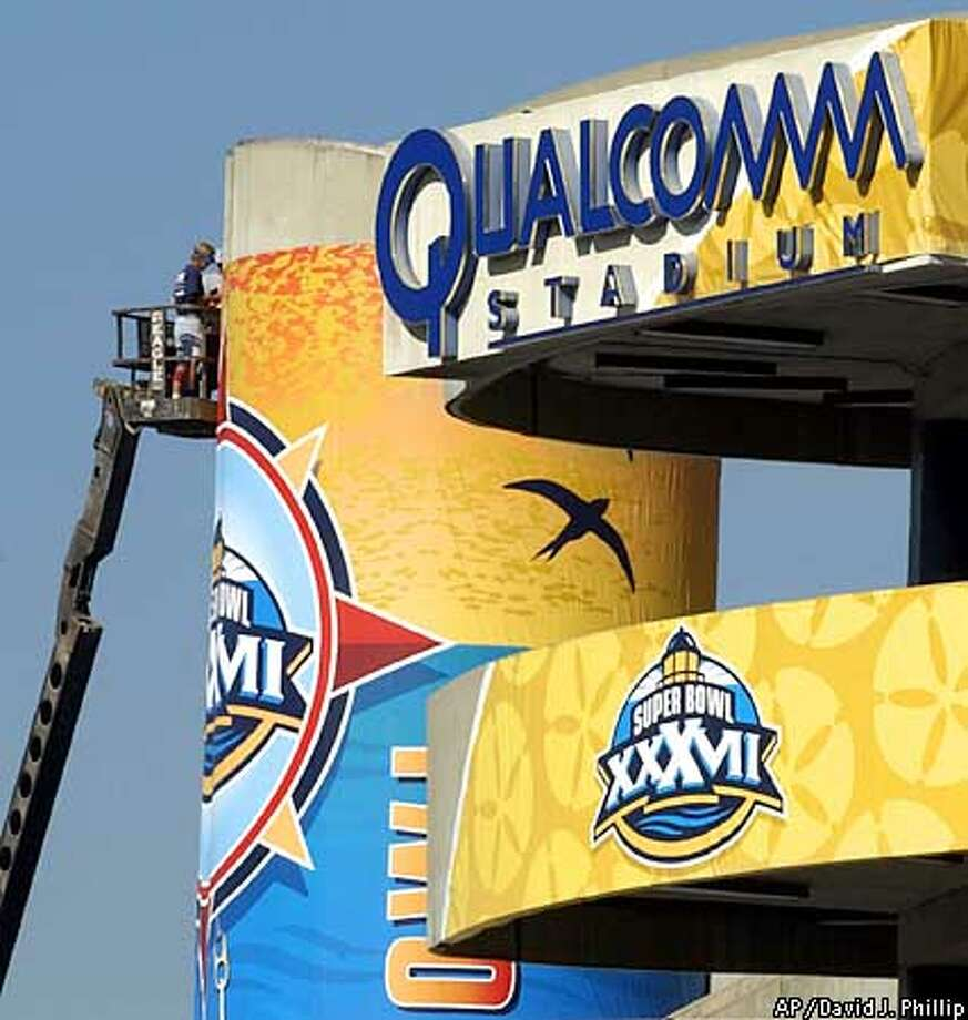 Workers put up a sign on Qualcomm Stadium Saturday, Jan. 18, 2003 in San Diego site of XXXVII. (AP Photo/David J. Phillip) Photo: DAVID J. PHILLIP