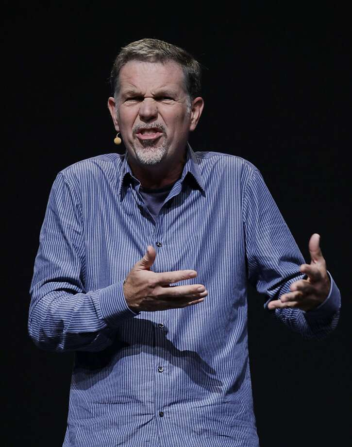 FILE - In this Sept. 23, 2011 file photo, Netflix CEO Reed Hastings gestures during the Facebook f/8 conference in San Francisco. To hear Hastings tell it, the bone-headed decisions that have dragged down the Internet's leading video subscription service during the past five months eventually will be forgotten like a bad movie made by a great film director.(AP Photo/Paul Sakuma, File) Photo: Paul Sakuma, Associated Press