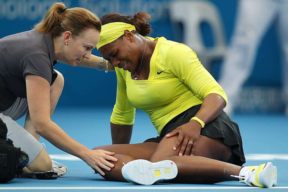 Serena Williams of the USA grimaces in pain after being injured during her match against Bojana Jovanovski during day four of the 2012 Brisbane International at Pat Rafter Arena on January 4, 2012 in Brisbane, Australia.