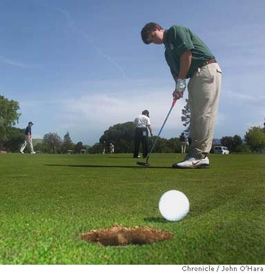 Diablo Creek Golf Course, Concord, CA.  Roberto Galletti, practices on the putting green  DeLasalle Golf Team just before a match  Photo/ John O'Hara Photo: John O'hara