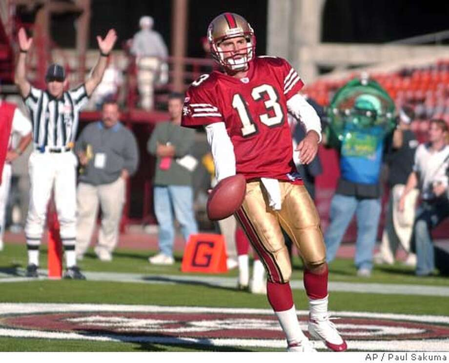 San Francisco 49ers quarterback Tim Rattay scores on a two-point conversion in the fourth quarter Sunday, Oct. 10, 2004, in San Francisco. The 49ers defeated the Cardinals, 31-28, in overtime. (AP Photo/Paul Sakuma) Sports#Sports#Chronicle#10/29/2004#ALL#5star##0422406473 Photo: PAUL SAKUMA
