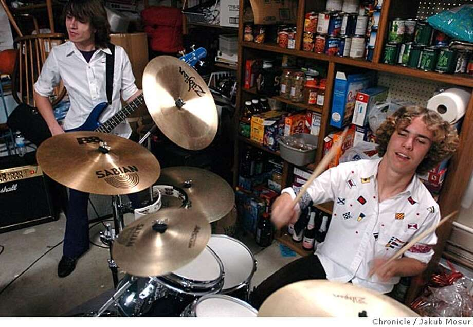 Shane Santos, 17, and Chris Carrasco, 16, of the band Azrael practice in the garage of the Casrrasco home in Martinez . Event on 4/17/05 in Martinez. JAKUB MOSUR / The Chronicle Photo: JAKUB MOSUR