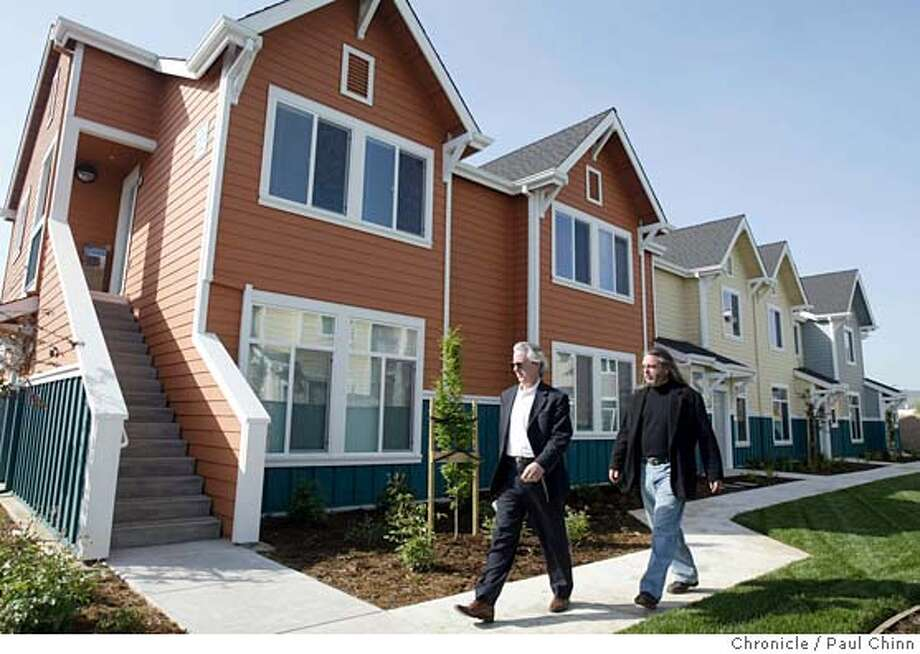 siliconvalley22_032_pc.jpg  Jeff Oberdorfer (left), executive director of First Community Housing, and Thomas Iamesi, director of housing development, walk through the Murphy Ranch Townhomes on 4/21/05 in Morgan Hill, CA. First Community Housing organization used money from a trust fund to construct the 100-unit community some of which are made available with an extremely low rent.  PAUL CHINN/The Chronicle MANDATORY CREDIT FOR PHOTOG AND S.F. CHRONICLE/ - MAGS OUT Photo: PAUL CHINN