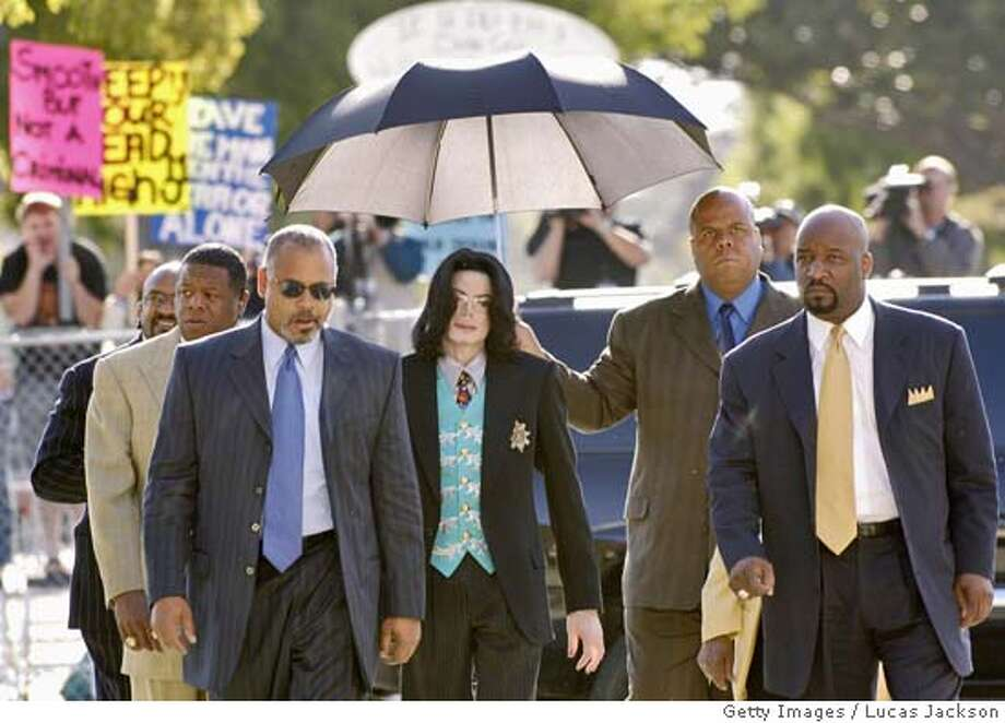 SANTA MARIA, CA - APRIL 21: Michael Jackson (C) arrives at the Santa Barbara County courthouse for his child molestation trial April 21, 2005 in Santa Maria California. Jackson is charged in a 10-count indictment with molesting a boy, plying him with liquor and conspiring to commit child abduction, false imprisonment and extortion. (Photo by Lucas Jackson-Pool/Getty Images) Photo: Pool