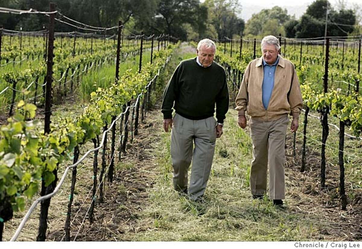 Arnold Palmer at Luna Vineyards in Napa, where he is an investor. Photo of Luna Vineyards owner, Michael Moone (right) and Arnold Palmer (left) walking through the vineyards. Event on 4/12/05 in Napa. Craig Lee / The Chronicle