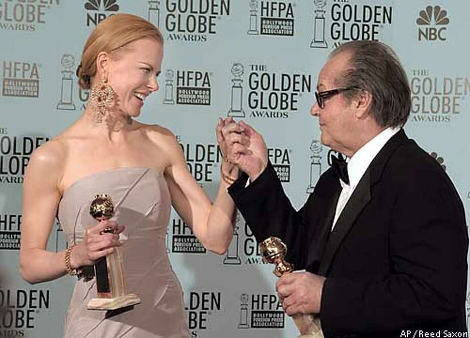 """Nicole Kidman left, and Jack Nicholson hold their best actress/actor awards for motion picture dramas for """"The Hours"""" and """"About Schmidt"""" respectively at the 60th annual Golden Globe Awards in Beverly Hills, Calif. Sunday, Jan. 19, 2003. (AP Photo/Reed Saxon) Photo: REED SAXON"""