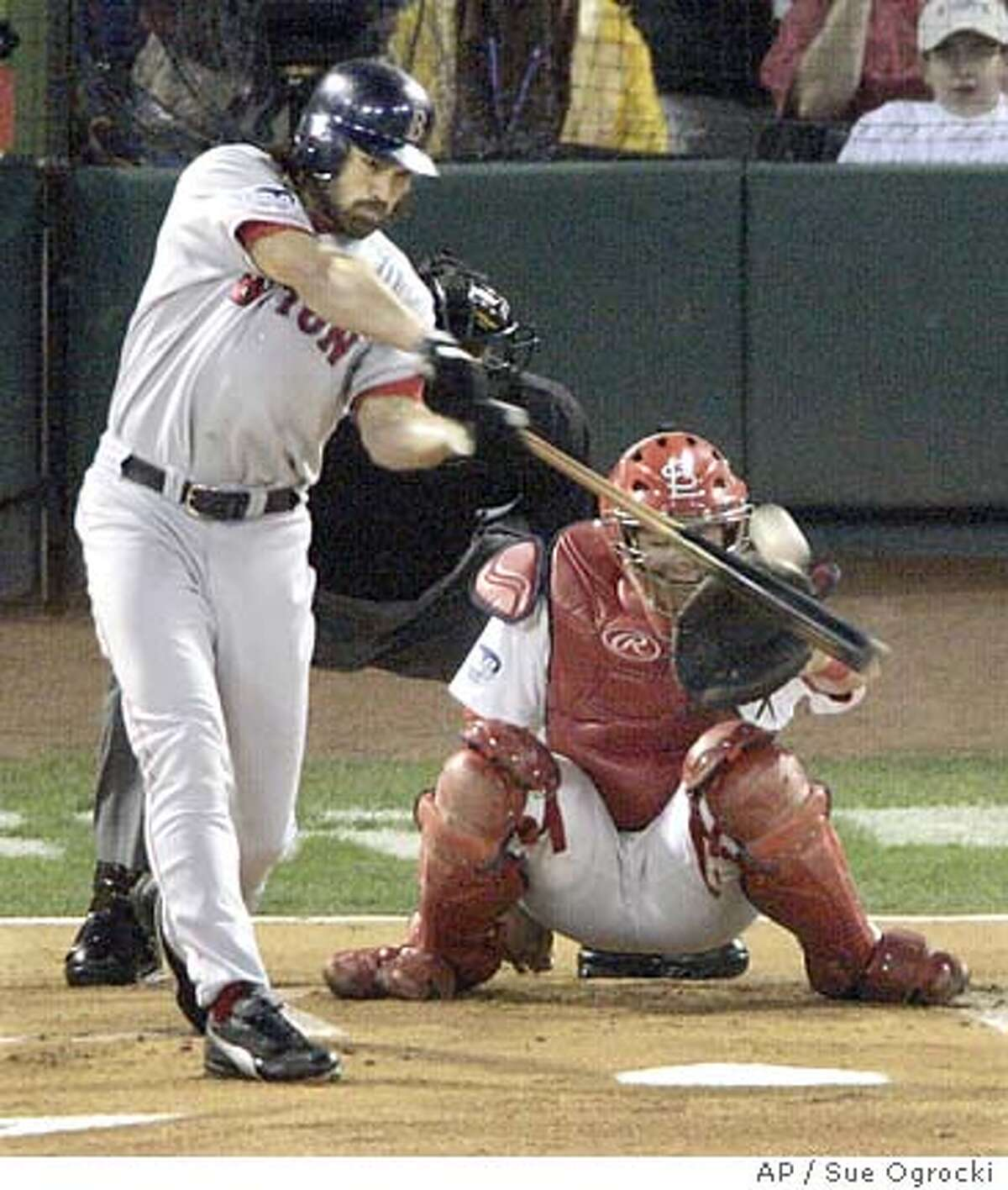 Boston Red Sox's Johnny Damon hits a solo home run in his first at bat in the first inning on a pitch from St. Louis Cardinals pitcher Jason Marquis in Game 4 of the World Series at Busch Stadium in St. Louis, Wednesday, Oct. 27, 2004. (AP Photo/Sue Ogrocki)