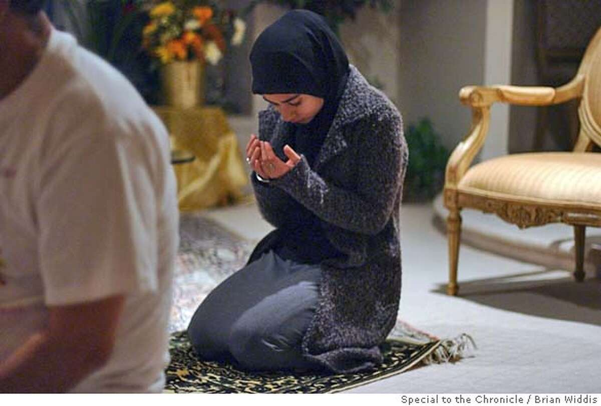 Sofia Begg, 18, of Bloomfield Hills, MI prays after sunset during Ramadan. special to Chronicle by Brian Widdis.