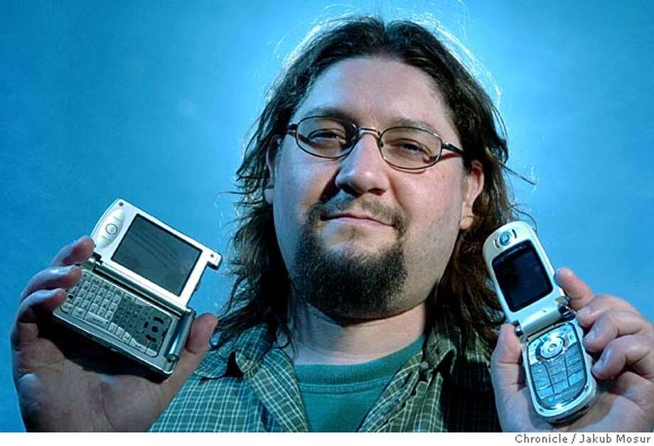 John Knutson holds two Motorola cellphones he has had composed ringtones for at his home in Richmond. Event on 4/17/05 in Richmond. JAKUB MOSUR / The Chronicle Photo: JAKUB MOSUR