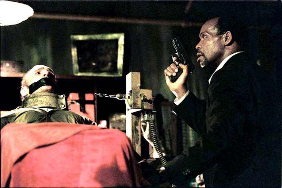SAW29 Ned Bellamy and Danny Glover in Saw. Photo credit: Greg Gayne/Lions Gate Films Datebook#Datebook#Chronicle#10/29/2004##Advance##0422435317