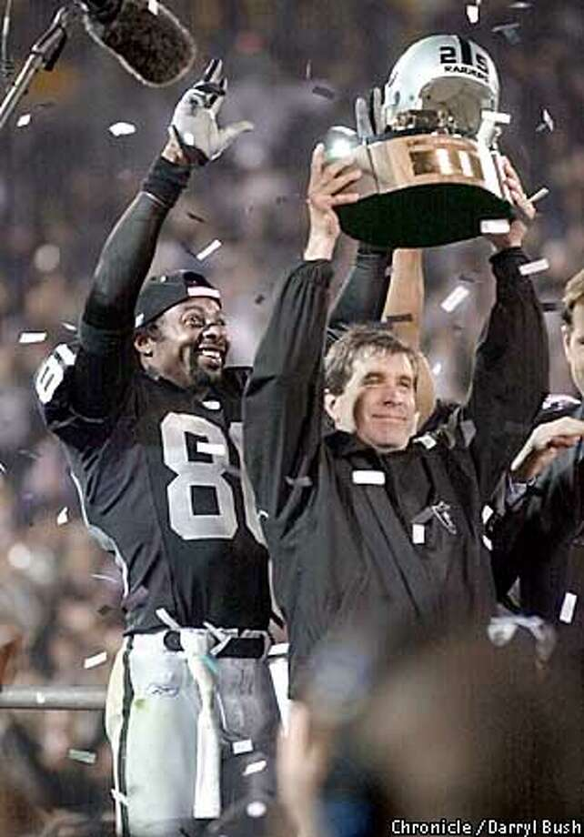 .jpg Raiders head coach Bill Callahan and Jerry Rice celebrate with their new AFC championship trophy. The Oakland Raiders play the Tennessee Titans in the AFC championship game in Oakland, Ca. January 19, 2003. Darryl Bush/San Francisco Chronicle Photo: Darryl Bush
