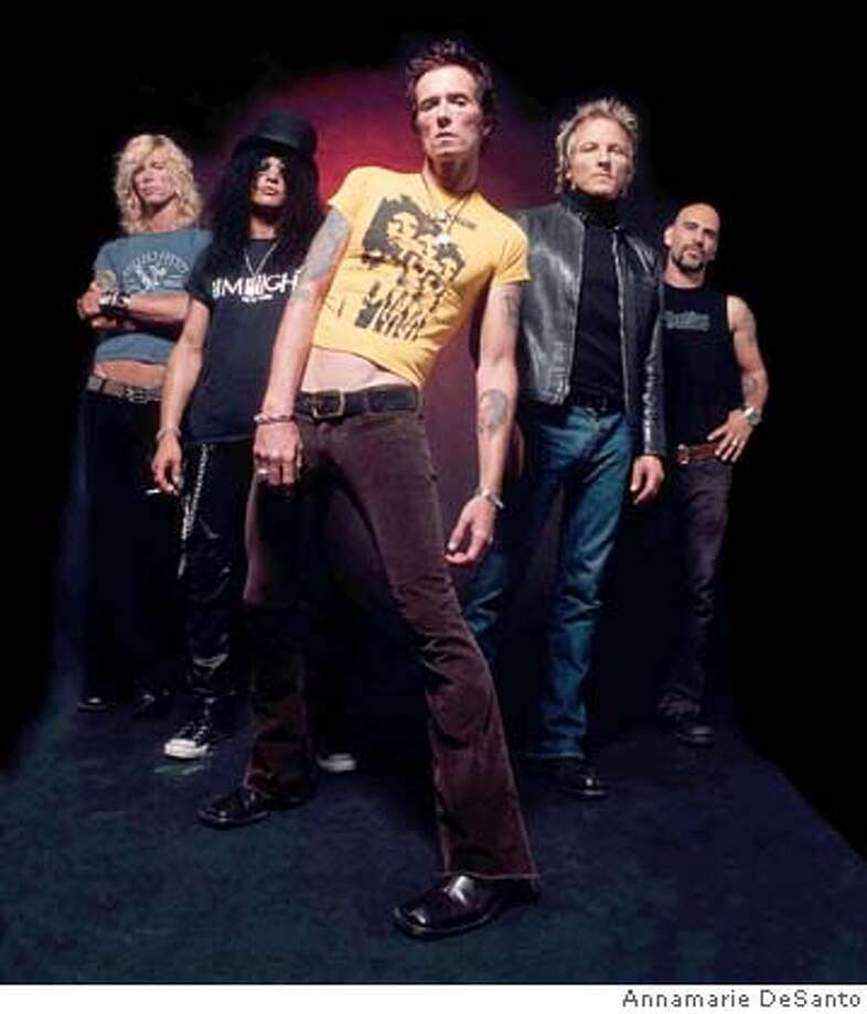 velvet Revolver Ran on: 04-17-2005  Velvet Revolver (from left): Duff McKagan, Slash, Scott Weiland, Matt Sorum and Dave Kushner. Ran on: 04-21-2005  Velvet Revolver: Reveling in retro hard rock in a ridiculous and magnificent concert at the Bill Graham Civic Auditorium. Photo: Annamarie DeSanto