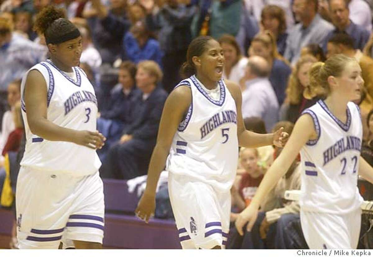 PARISTWINSe-C-14MAR03-SP-MK --- Piedmont High School Basketball players, Courtney and Ashley Paris in action together during their game against Salinas at home. BY MIKE KEPKA/THE CHRONICLE Sports#Sports#Chronicle#10/28/2004#ALL#5star##421196287