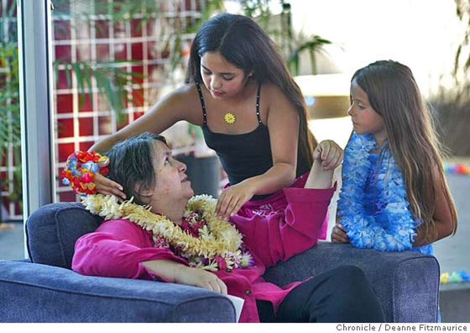 mom18_039_df.JPG  Single mom, Kitty Sanford, who is dying of cancer has a fundraiser at the Children's Discovery Museum to raise money for her daughter, Kuuleilani, 10, (who is putting a lei on her mother) for after she is gone. Friend, Amber Fernandez, 6, looks on. This was shot in San Jose.  Deanne Fitzmaurice / The Chronicle Ran on: 07-18-2004 Ran on: 07-18-2004 MANDATORY CREDIT FOR PHOTOG AND SF CHRONICLE/ -MAGS OUT Metro#Metro#Chronicle#10/28/2004#ALL#5star##0422202780 Photo: Deanne Fitzmaurice