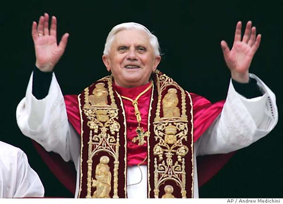 Newly elected Pope Joseph Ratzinger of Germany waves to the crowd from the central balcony of St. Peter's Basilica, at the Vatican, Tuesday, April 19, 2005. (AP Photo/ Andrew Medichini) Photo: ANDREW MEDICHINI