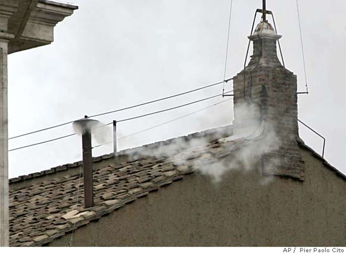 White smoke billows from the chimney atop the Sistine Chapel, at the Vatican, Tuesday, April 19, 2005 to announce the election of Pope Benedict XVI. Joseph Ratzinger of Germany, who took the name of Benedict XVI, became the 265th pontiff of the Roman Catholic Church. (AP Photo/ Pier Paolo Cito)