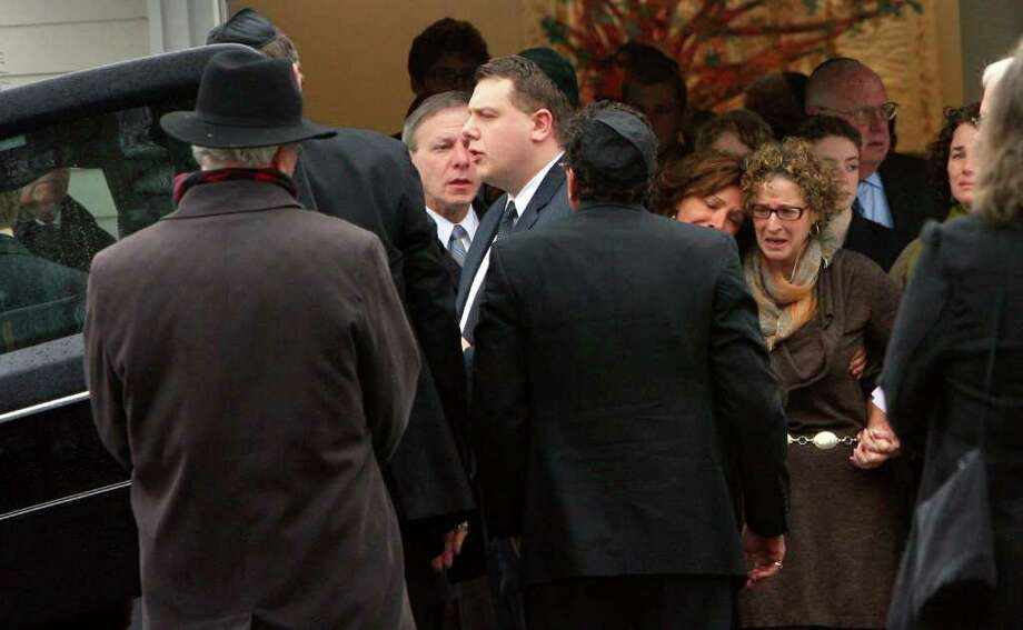 Barbara Stark Block, right, follows the casket of her daughter, Eva Block, after a memorial service in Fairfield, Conn.on Monday, January 23, 2012. Block was a Marist college student from Woodbridge, who was killed in a house fire near campus in Poughkeepsie, N.Y. early Saturday morning. She was born in Bridgeport, Conn. Photo: B.K. Angeletti / Connecticut Post