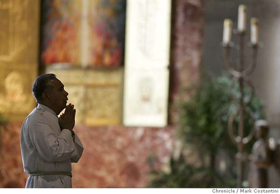 POPEREAX_070_mc.jpg  St. Mary's Eucharistic minister Jess Covita prays during mass. Mass at St. Mary's Church on Geary Blvd. For Pope reax story.  Mark Costantini/San Francisco Chronicle MANDATORY CREDIT FOR PHOTOG AND SF CHRONICLE/ -MAGS OUT Photo: Mark Costantini