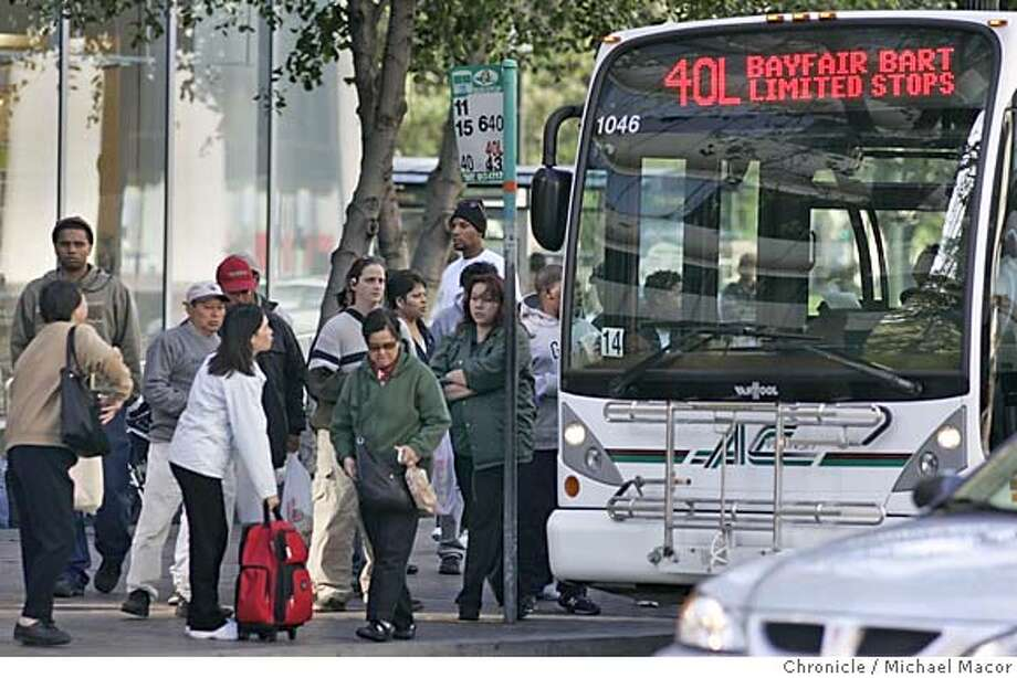 discrimination_146_mac.jpg Afternoon rush hour at the corner of Broadway and 14th St. in Oakland. When Sylvia Darensburg started riding AC Transit buses to work from her East Oakland home about 25 years ago, the fare was 50 cents and routes ran directly to other cities. Now a ride costs $1.50, routes are shorter, service is down, and more cuts lie ahead as the system struggles with a deficit. Meanwhile billions are being pumped into suburban commute lines on CalTran and BART. The reason, civil rights advocates charged in a federal court suit Tuesday, is racial discrimination in subsidies acquired and distributed by the Metropolitan Transportation Commission, in charge of transit funding for the nine Bay Area counties. The suit, modeled on successful litigation in Los Angeles a decade ago, seeks to reorder the MTC�s priorities from trains to buses. 4/19/05 Oakland, Ca Michael Macor / San Francisco Chronicle Mandatory Credit for Photographer and San Francisco Chronicle/ - Magazine Out Photo: Michael Macor