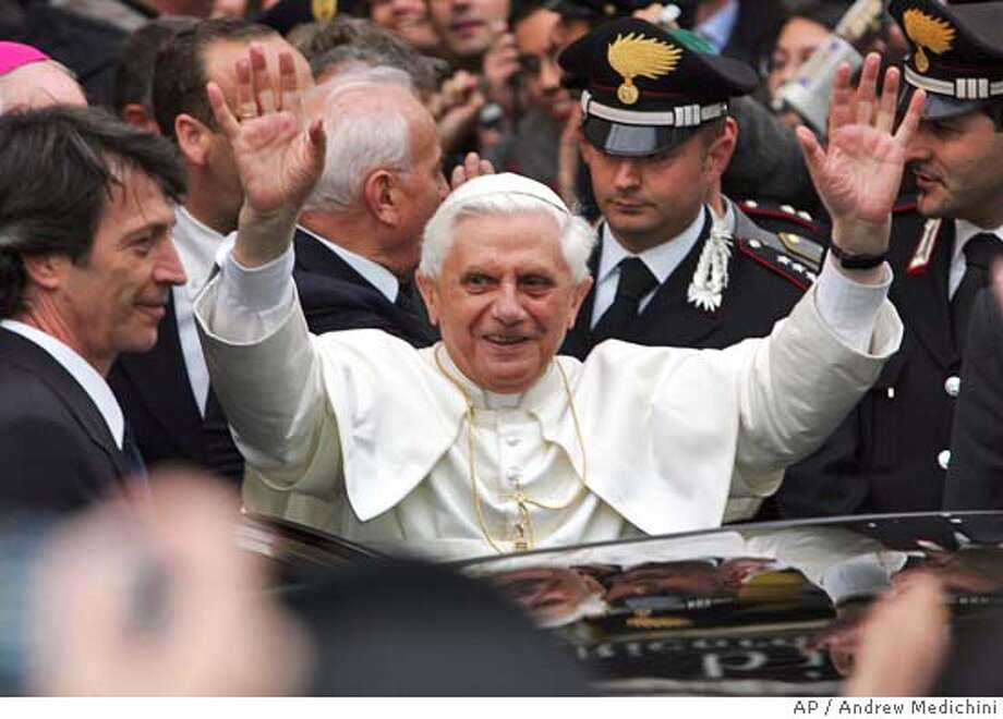 Pope Benedict XVI greets the crowd gathered in front of his former private home in Rome, Wednesday, April 20, 2005. The Pontiff, former Cardinal Joseph Ratzinger of Germany, exited the Vatican City Wednesday for a quick visit to his former home in Rome. (AP Photo/Andrew Medichini) Photo: ANDREW MEDICHINI