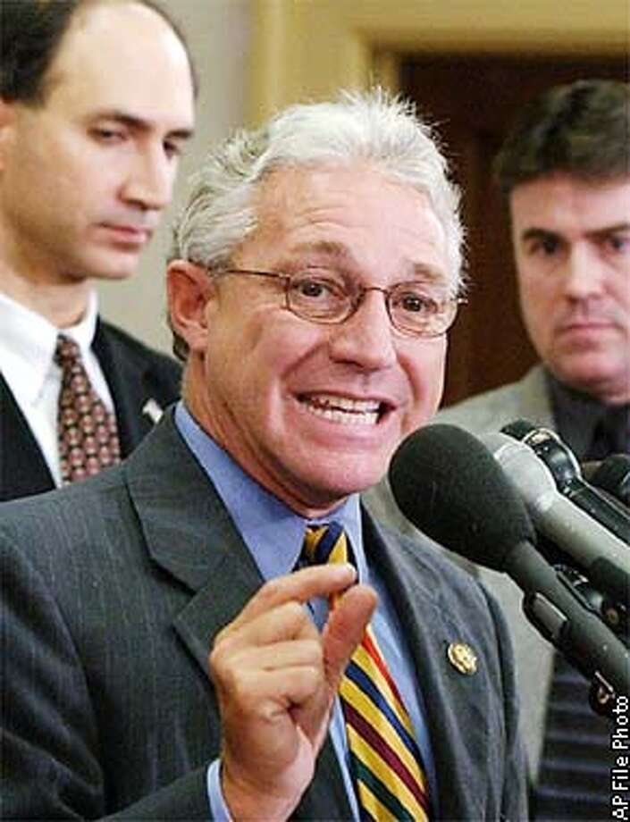 Representative James Greenwood, R-Pa., center, chairman of the House Energy and Commerce Oversight and Investigations Subcommittee and full committee Chairman Rep. Billy Tauzin, R-La., left, asked the Justice Department Tuesday, Sept. 10, 2002, to begin criminal investigation into whether knowingly lied to the committee about the sale of her Imclone stock. Also appearing at a Capitol Hill news conference in the background are committee investigator Alan Slobodin, center, and Ken Johnson, right, a member of Tauzin's staff. (AP Photo/Dennis Cook)  ALSO RAN 12/09/02 Photo: DENNIS COOK
