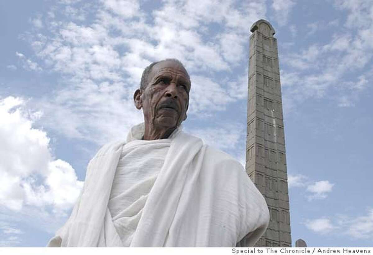 Photo of Abebe Alemyehu in front of one of the Axum obelisks that the Italians did not steal. Photo by Andrew Heavens/Special to The Chronicle