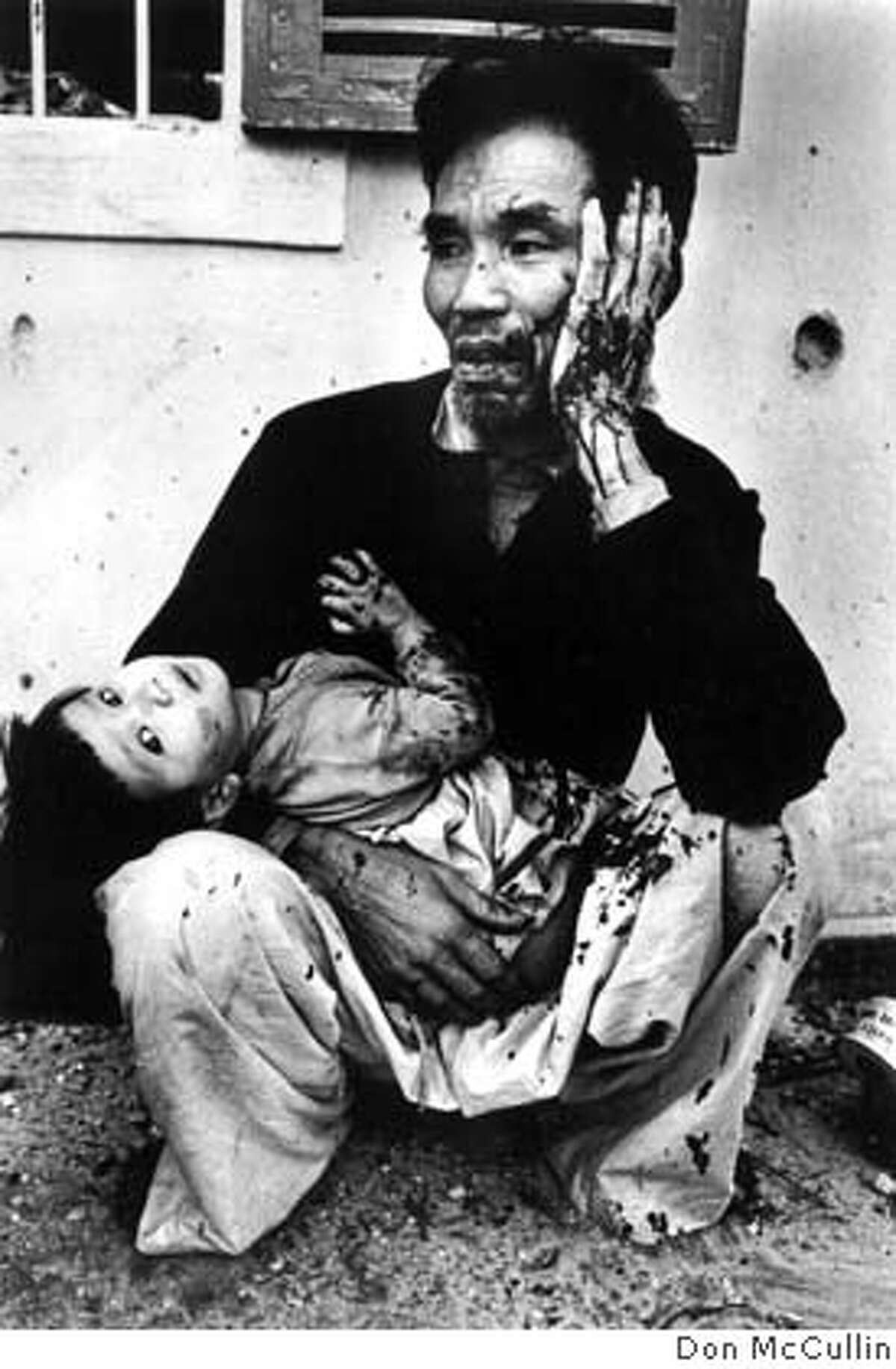 Father and daughter wounded when US Marines dropped hand grenades into their bunker, Tet offensive, battle of Hu�, South Vietnam, February 1968 Don McCullin Don McCULLIN's Day Nine