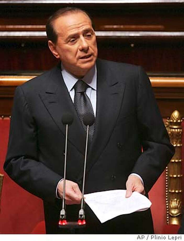 Italian Premier Silvio Berlusconi addresses the Senate in Rome, Wednesday, April 20, 2005, announcing that he will resign, ending the country's longest-serving postwar government. (AP Photo/Plinio Lepri) Photo: PLINIO LEPRI