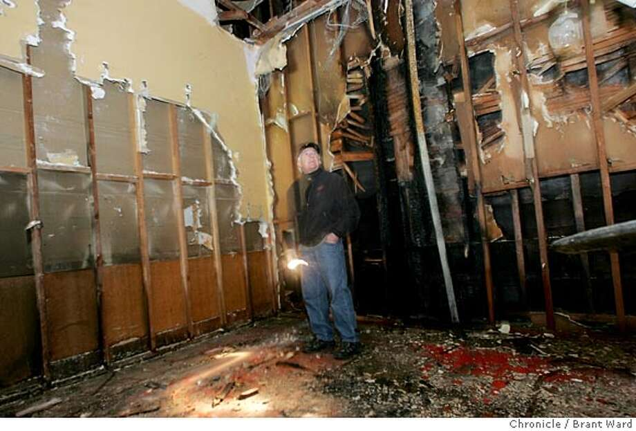 Jeff Varacalli, one of the owners of the Fior d'Italia looked at the damage to the main dining room of the famous restaurant.  The Fior d' Italia restaurant in San Francisco suffered major damage in its' main dining room early Tuesday morning from a fire. The restaurant at Union and Stockton Streets claims to be the oldest American Italian restaurant.  Brant Ward 2/16/05 Photo: Brant Ward