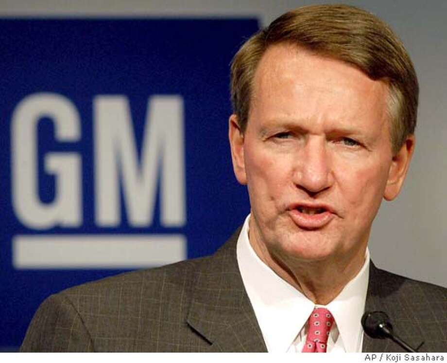 ** FILE ** General Motors Corp. Chief Executive Rick Wagoner addresses a joint press conference with leaders of three Japanese automakers, Isuzu Motors, Suzuki Motor Corp. and Fuji Heavy Industries, the maker of Subaru cars, in Tokyo Monday, Oct. 20, 2003. Wagoner said Monday, April 4, 2005, he will take over daily responsibility of the huge automaker's struggling North American division. (AP Photo/Koji Sasahara) OCT. 20, 2003, PHOTO Photo: KOJI SASAHARA