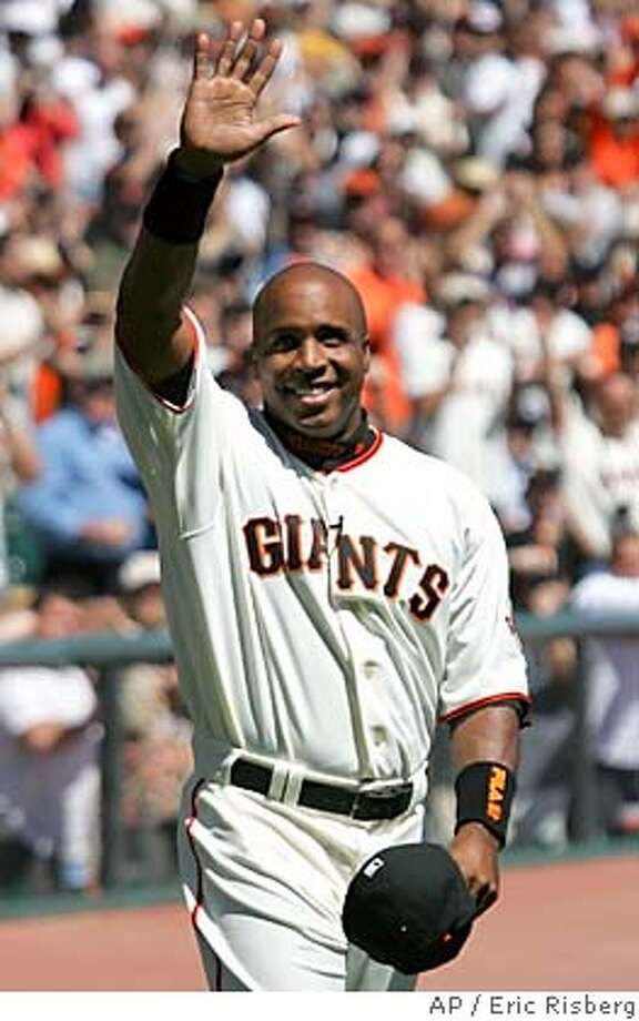 San Francisco Giants' Barry Bonds waves to fans while being introduced before the Giants played the Los Angeles Dodgers in San Francisco, Tuesday, April 5, 2005. The injured Bonds received a 1-minute standing ovation from the sellout crowd and emphatically declared ``I will be back!'' when introduced before the Giants' opener Tuesday. (AP Photo/Eric Risberg) Photo: ERIC RISBERG