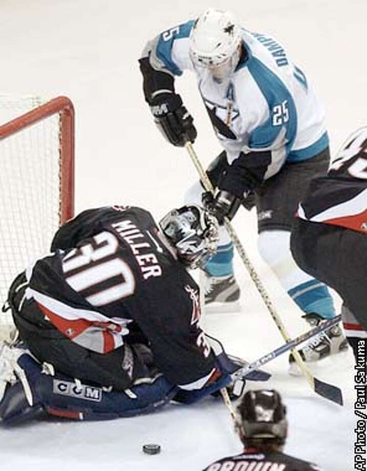 San Jose Sharks center Vincent Damphousse is unable to score past Buffalo Sabres goalie Ryan Miller in the first period, Thursday, Jan. 16, 2003, in San Jose, Calif. (AP Photo/Paul Sakuma) Photo: PAUL SAKUMA