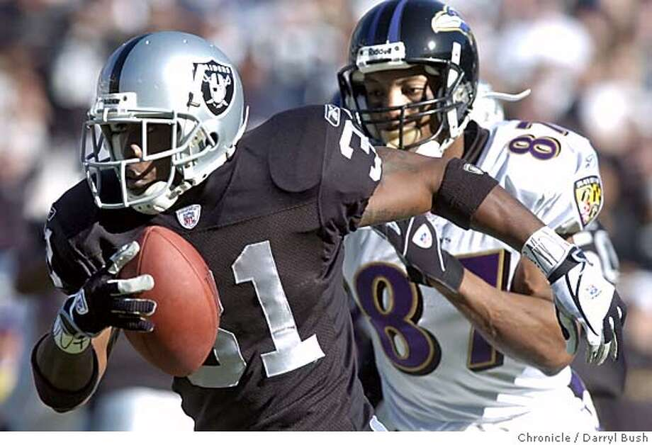 raiders15_056db.jpg  Oakland Raiders Phillip Buchanon runs back an interception he made in the 1st qtr. vs. Baltimore Ravens at Networks Associates coliseum. 12/14/03 in Oakland. DARRYL BUSH / The Chronicle Ran on: 09-09-2004  Phillip Buchanon: more consistent? ALSO Ran on: 11-28-2004  Ray Buchanan, who dubbed himself &quo;Big Play Ray'' during his years with Colts and Falcons, has one interception for Oakland. Ran on: 12-30-2004 Ran on: 12-30-2004 MANDATORY CREDIT FOR PHOTOG AND SF CHRONICLE/ -MAGS OUT Photo: DARRYL BUSH