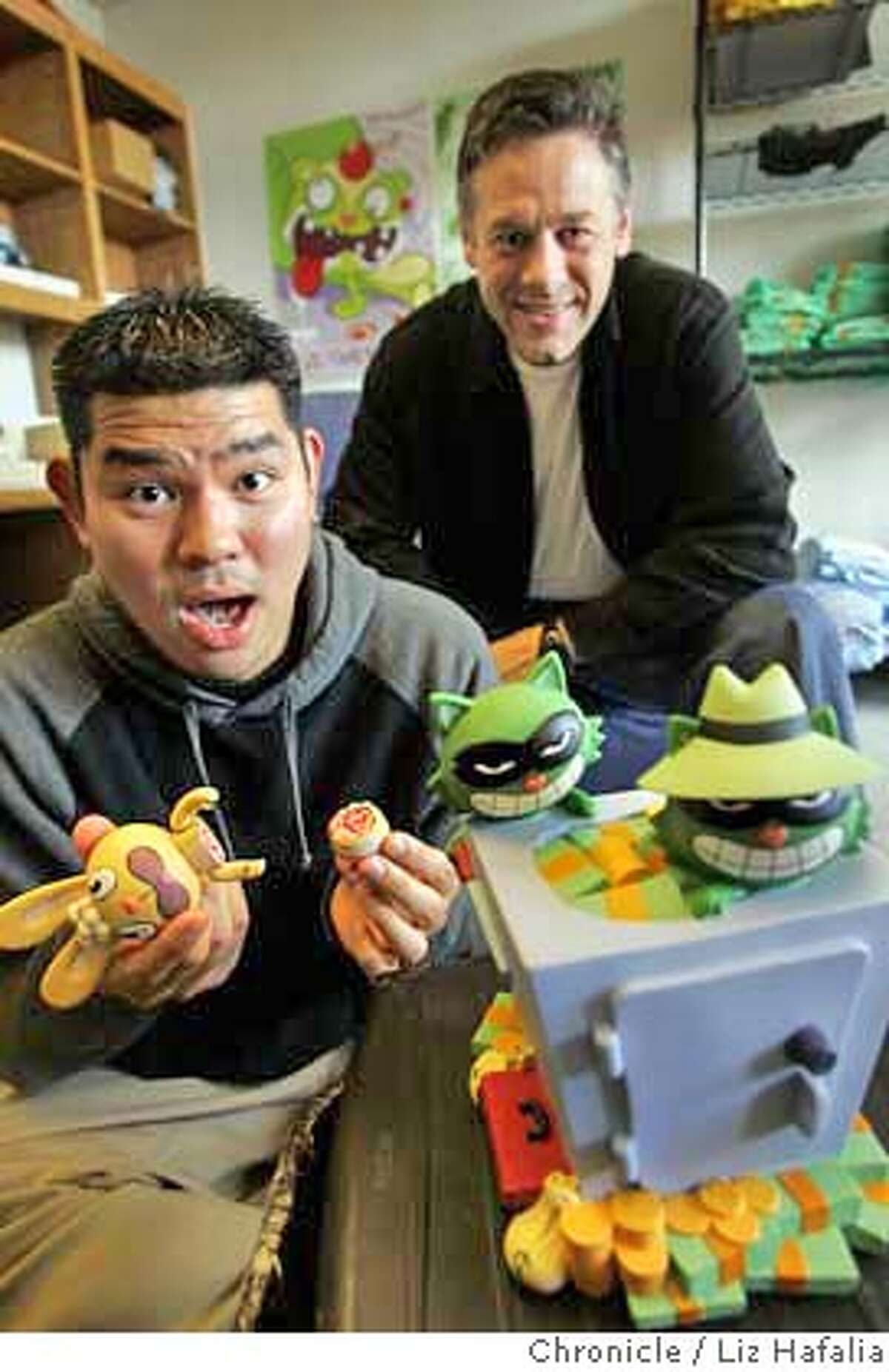 MONDO25_039_LH.JPG CEO John Evershed of Mondo Media and Kenn Navarro, the creator of Happy Tree Friends. Kenn is holding Cuddles, who he does voice over for, and on the safe are characters Lifty (left) and Shifty (right, with hat)--kleptomaniac racoon brothers. Shot on 10/20/04 in San Francisco. LIZ HAFALIA/The Chronicle MANDATORY CREDIT FOR PHOTOG AND SF CHRONICLE/ -MAGS OUT Business#Business#Chronicle#10/25/2004##5star##0422426168