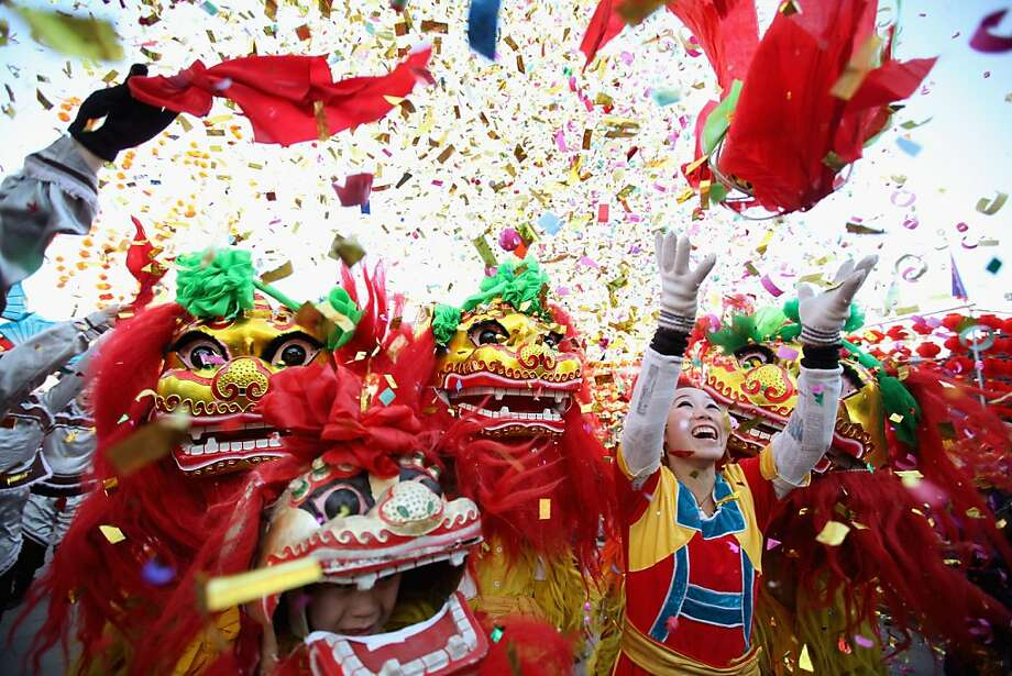 Chinese folk artists perform the lion dance at a temple fair to celebrate the Lunar New Year of Dragon on January 22, 2012 in Beijing, China. Falling on January 23 this year, the Chinese Lunar New Year, also known as the Spring Festival, which is based on the Lunisolar Chinese calendar, is celebrated from the first day of the first month of the lunar year and ends with Lantern Festival on the Fifteenth day. Photo: Feng Li, Getty Images