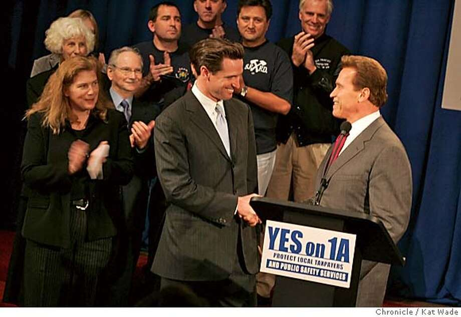 ARNOLD26015_KW.jpg  On 10/25/04 in San Francisco (L to R) Joanne Hayes-White, the Chief of SF Fire Department watches asSan Francisco Mayor Gavin Newsome and California Governor Arnold Schwarzenegger shake hands and stand side-by-side at a press conference to show their support for Proposition 1A, which would prevent the state legislature from taking and using local government funds, which is on the November 2 ballot . Chronicle Photo by Kat Wade Mags out/mandatory credits San Francisco Chronicle and photographer/ Metro#Metro#Chronicle#10/26/2004#ALL#5star##0422432281 Photo: Kat Wade
