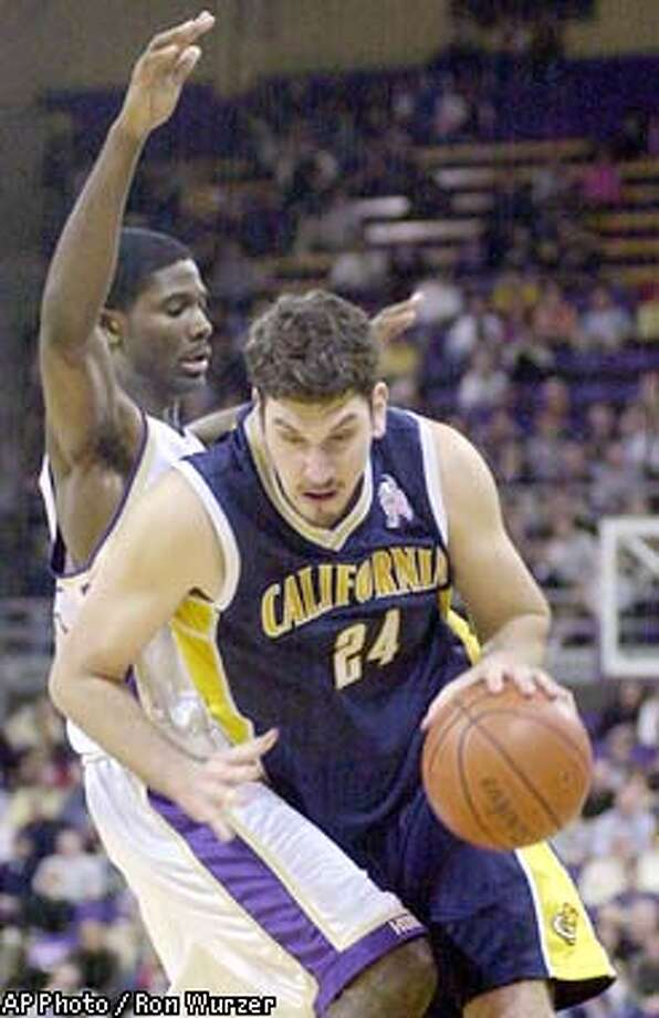 California's Amit Tamir, right, drives past Washington's Bobby Jones, left, in the second half in Seattle on Thursday, Jan 16, 2003. California won 73-66. (AP Photo / Ron Wurzer) Photo: RON WURZER
